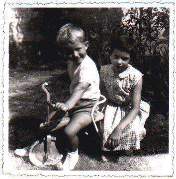With sister on first trike (1960)
